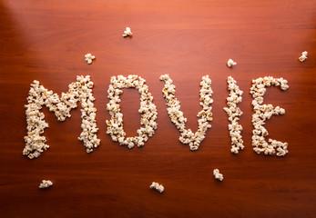 """Word """"movie"""" written with popcorn"""