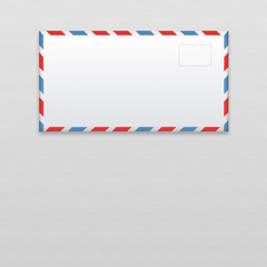 Post envelope on gray wooden background.