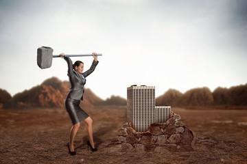 Businesswoman with sledgehammer
