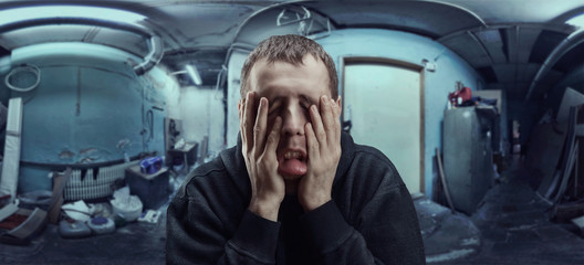 Depressed man with palms on his cheeks