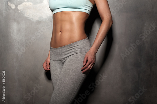 Fitness female woman with muscular body, do her workout, abs, ab