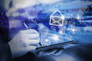 Business woman are sending email marketing by using digital tabl