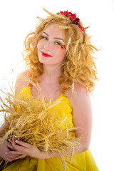 Beautiful girl dressed yellow with wheaten ears