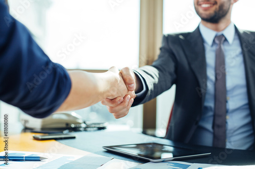 Close up of business handshake in the office - 81808080