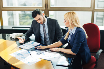 Businesswoman pointing at business document during discussion at