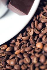 Coffee beens, chocolate, cup of coffee