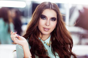 Woman with trendy smokey eyes makeup