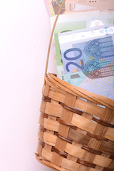 european money on wooden basket, dollars, euro