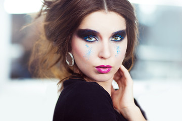The woman with a creative smoky eyes make-up