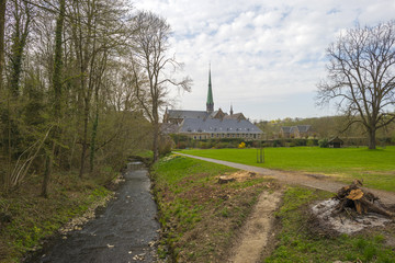 Stream through the park of an abbey in spring