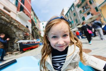 Little girl in Riomaggiore village in Cinque Terre