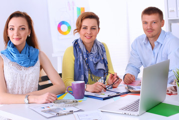 Young business people working at office on new project