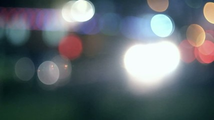 Defocused carlights in the night toned colorized footage