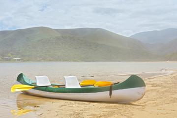 Tourist boat on misty lake