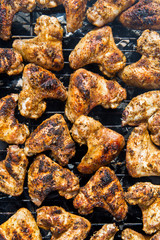 Spiced Chicken Wings on Grill. Seasoned Chicken Wings Barbecue.