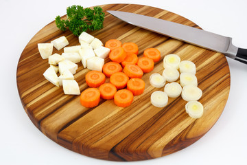 Cutted mirepoix on wooden cutting board with knife