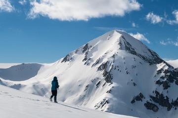 Female Hiker in Winter Mountain