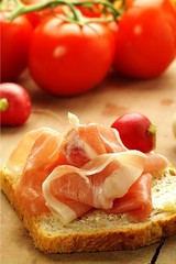 ham sandwich on a background with tomatoes