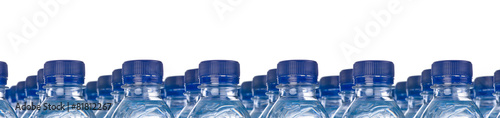 Rows of water bottles panoramic isolated on white background