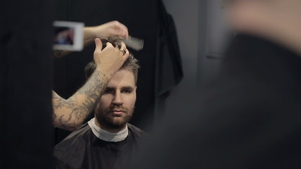 Barber Cuts the Hair in the Barbershop