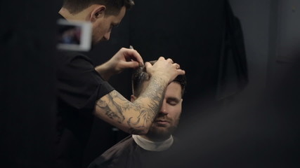 Barber Cuts the Hair in the Barbershop. Slow Motion
