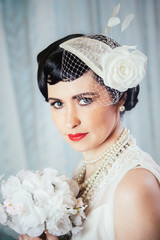 Bride with hair ornament and bouquet