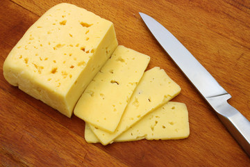 A piece of cheese and a knife