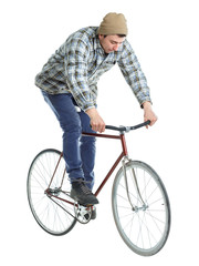 Young man doing tricks on a bicycle on a white