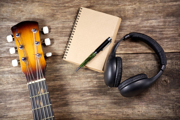 headphone guitar notebook pencil