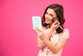 Beautiful woman making makeup