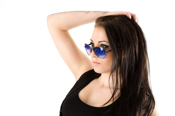 girl in sunglasses with a tattoo on his arm