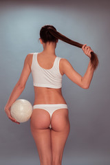 Woman in Undies with Volleyball Ball in Rear View