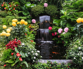 The fountain surrounded by flowers