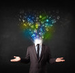 Business man with glowing media icons exploding head