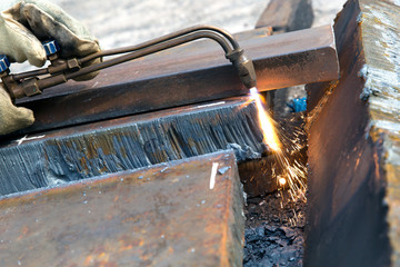 Cutting metal sheet with propane oxygen gas blow torch burner