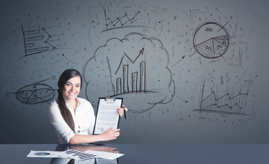businesswoman with business diagrams