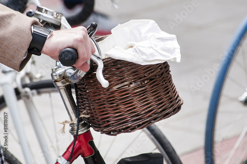 Fotobehang Fiets Pretty retro front wicker bicycle basket closeup