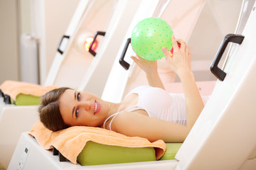 Young woman on Thermoslim therapy exercise in capsule