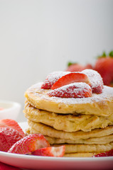 Fluffy pancakes with strawberries
