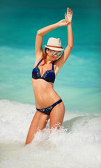 Sexy woman on the sea background