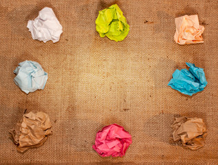 crumpled colorful paper on background creative process