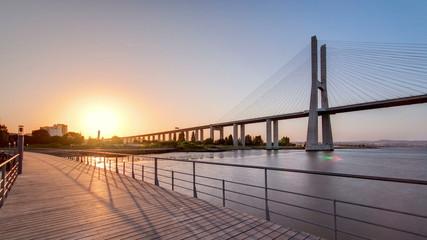 Vasco da Gama bridge during sunset and ebb-tide in Lisbon