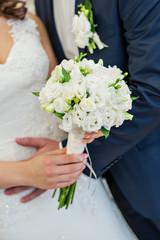 Bride holding a beautiful wedding bouquet