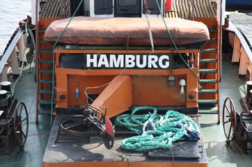 "details of  Old german boat with a title ""Hamburg"" in a port Ham"