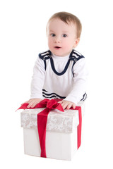 baby boy toddler with gift box isolated on white