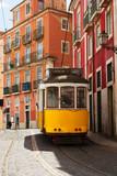 tram on narrow street of Alfama, Lisbon
