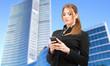 Businesswoman sending a sms