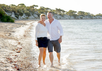 young couple in love walking on beach romantic summer holidays