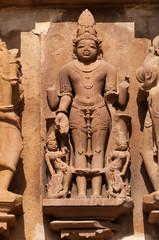 carved sculptures of Male Deity on Chitragupta temple. Khajuraho