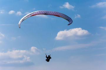 Paraglider high in in the sky
